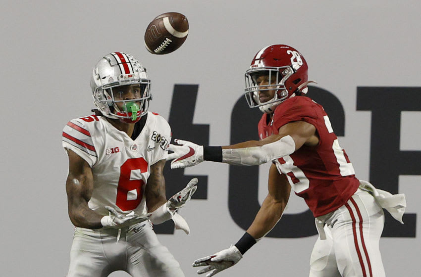 MIAMI GARDENS, FLORIDA - JANUARY 11: Jameson Williams #6 of the Ohio State Buckeyes attempts a reception against Josh Jobe #28 of thee Alabama Crimson Tide during the CFP National Championship Presented by AT&T at Hard Rock Stadium on January 11, 2021 in Miami Gardens, Florida. (Photo by Sam Greenwood/Getty Images)