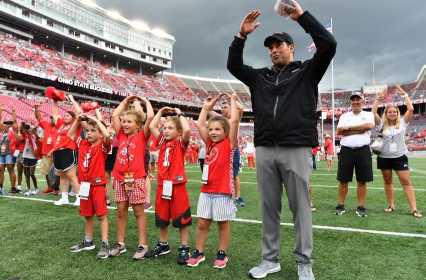 COLUMBUS, OH - SEPTEMBER 1: Acting Head Coach Ryan Day of the Ohio State Buckeyes sings Carmen Ohio with family after earning his first victory against the Oregon State Beavers at Ohio Stadium on September 1, 2018 in Columbus, Ohio. Ohio State defeated Oregon State 77-31. (Photo by Jamie Sabau/Getty Images)
