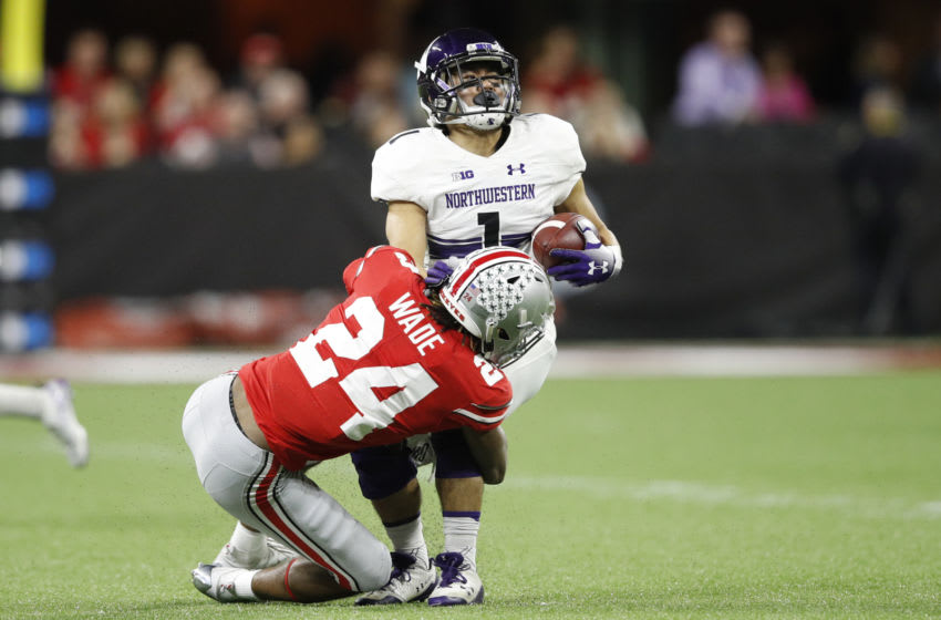 INDIANAPOLIS, INDIANA - DECEMBER 01: Chad Hanaoka #1 of the Northwestern Wildcats is tackled by Shaun Wade #24 of the Ohio State Buckeyes in the second quarter at Lucas Oil Stadium on December 01, 2018 in Indianapolis, Indiana. (Photo by Joe Robbins/Getty Images)