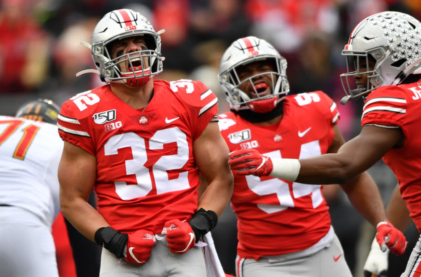 COLUMBUS, OH - NOVEMBER 9: Tuf Borland #32 celebrates a first quarter sack with Tyler Friday #54 of the Ohio State Buckeyes against the Maryland Terrapins at Ohio Stadium on November 9, 2019 in Columbus, Ohio. (Photo by Jamie Sabau/Getty Images)