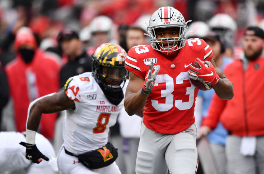 COLUMBUS, OH - NOVEMBER 9: Master Teague III #33 of the Ohio State Buckeyes takes off on a 30-yard run in the second quarter as Marcus Lewis #8 of the Maryland Terrapins gives chase at Ohio Stadium on November 9, 2019 in Columbus, Ohio. (Photo by Jamie Sabau/Getty Images)