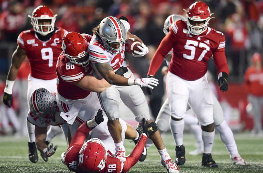 PISCATAWAY, NEW JERSEY - NOVEMBER 16: Brendan Bordner #88 of the Rutgers Scarlet Knights tackles Steele Chambers #22 of the Ohio State Buckeyes as he carries the ball during the second half of their game at SHI Stadium on November 16, 2019 in Piscataway, New Jersey. (Photo by Emilee Chinn/Getty Images)