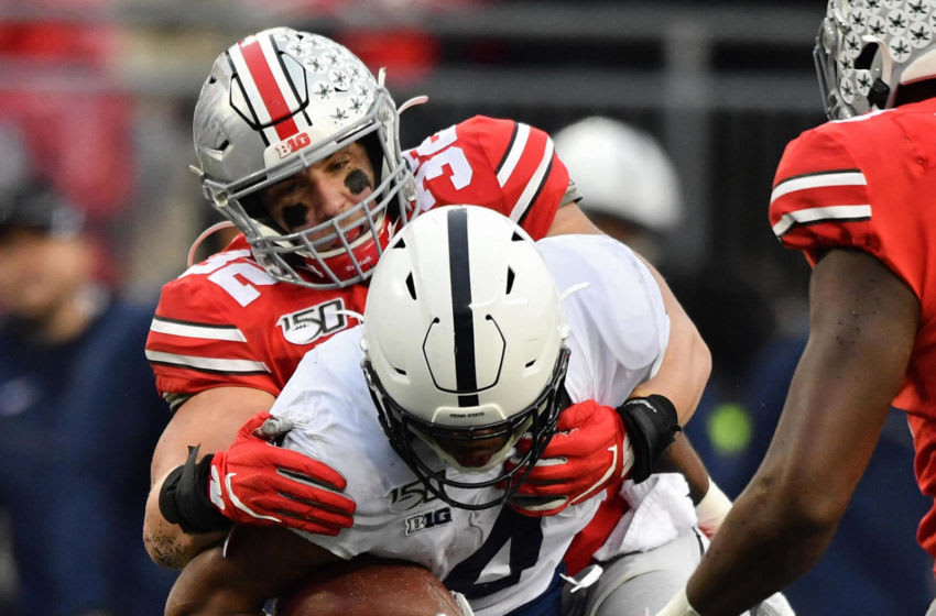 COLUMBUS, OH - NOVEMBER 23: Tuf Borland #32 of the Ohio State Buckeyes tackles Journey Brown #4 of the Penn State Nittany Lions at Ohio Stadium on November 23, 2019 in Columbus, Ohio. (Photo by Jamie Sabau/Getty Images)