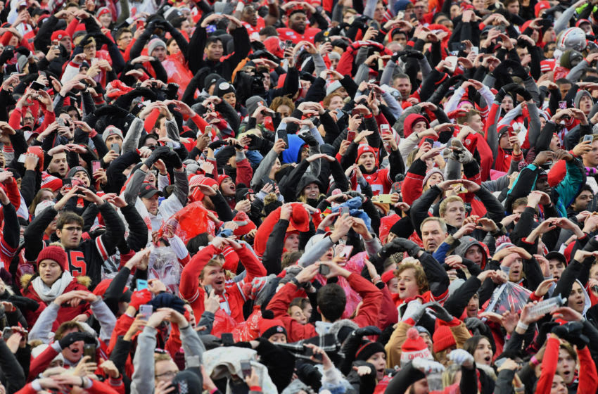 COLUMBUS, OH - NOVEMBER 23: Fans sing the Ohio State University Alma Mater on the field after the Ohio State Buckeyes defeated the Penn State Nittany Lions 28-17 at Ohio Stadium on November 23, 2019 in Columbus, Ohio. (Photo by Jamie Sabau/Getty Images) *** Local Caption ***