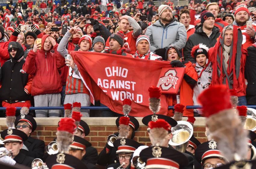 ANN ARBOR, MICHIGAN - NOVEMBER 30: Ohio State Buckeye fans celebrate after a college football game against the Michigan Wolverines at Michigan Stadium on November 30, 2019 in Ann Arbor, MI. The Ohio State Buckeyes won the game 56-27 over the Michigan Wolverines. (Photo by Aaron J. Thornton/Getty Images)