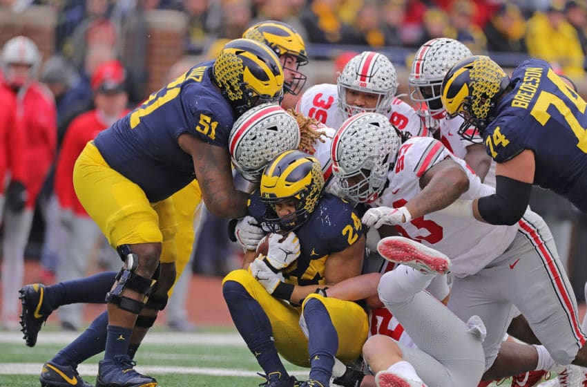 ANN ARBOR, MI - NOVEMBER 30: Davon Hamilton #53 of the Ohio State Buckeyes makes the stop on Zach Charbonnet #24 of the Michigan Wolverines during the third quarter of the game at Michigan Stadium on November 30, 2019 in Ann Arbor, Michigan. Ohio State defeated Michigan 56-27. (Photo by Leon Halip/Getty Images)