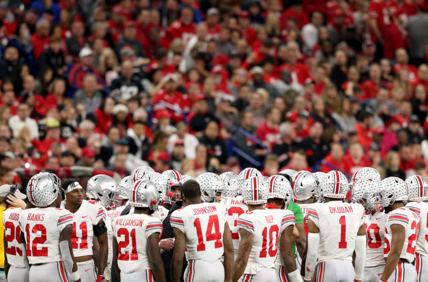 INDIANAPOLIS, INDIANA - DECEMBER 07: The Ohio State Buckeyes huddle up in the Big Ten Championship game against the Wisconsin Badgers at Lucas Oil Stadium on December 07, 2019 in Indianapolis, Indiana. (Photo by Justin Casterline/Getty Images)