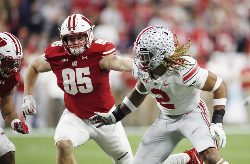 INDIANAPOLIS, IN - DECEMBER 07: Cormac Sampson #85 of the Wisconsin Badgers blocks against Chase Young #2 of the Ohio State Buckeyes during the Big Ten Football Championship at Lucas Oil Stadium on December 7, 2019 in Indianapolis, Indiana. Ohio State defeated Wisconsin 34-21. (Photo by Joe Robbins/Getty Images)