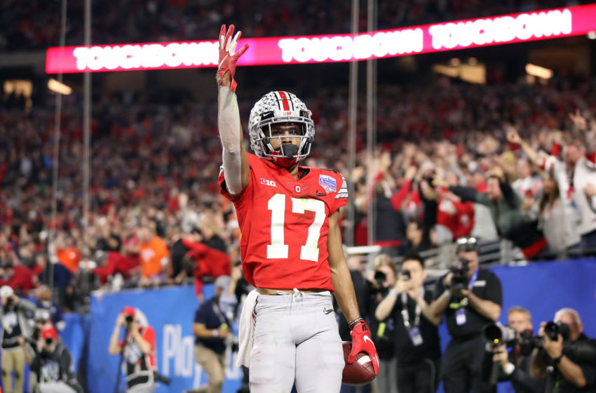 GLENDALE, ARIZONA - DECEMBER 28: Chris Olave #17 of the Ohio State Buckeyes celebrates his touchdown reception against the Clemson Tigers in the second half during the College Football Playoff Semifinal at the PlayStation Fiesta Bowl at State Farm Stadium on December 28, 2019 in Glendale, Arizona. (Photo by Christian Petersen/Getty Images)