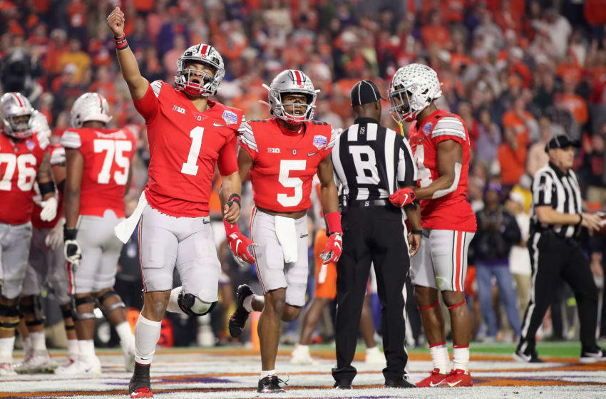GLENDALE, ARIZONA - DECEMBER 28: Quarterback Justin Fields #1 of the Ohio State Buckeyes reacts alongside Garrett Wilson #5 during the PlayStation Fiesta Bowl at State Farm Stadium on December 28, 2019 in Glendale, Arizona. The Tigers defeated the Buckeyes 29-23. (Photo by Christian Petersen/Getty Images)