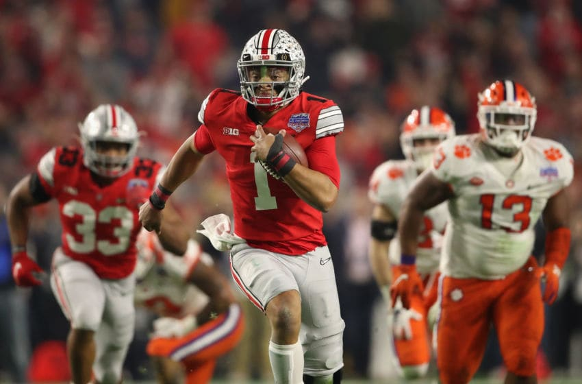 GLENDALE, ARIZONA - DECEMBER 28: Quarterback Justin Fields #1 of the Ohio State Buckeyes scrambles with the football during the PlayStation Fiesta Bowl against the Clemson Tigers at State Farm Stadium on December 28, 2019 in Glendale, Arizona. The Tigers defeated the Buckeyes 29-23. (Photo by Christian Petersen/Getty Images)