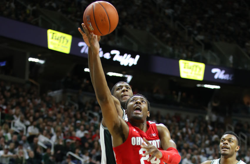 EAST LANSING, MICHIGAN - MARCH 08: Andre Wesson #24 of the Ohio State Buckeyes tries to get a shot off past Aaron Henry #11 of the Michigan State Spartans during the second half at the Breslin Center on March 08, 2020 in East Lansing, Michigan. Michigan State won the game 80-69. (Photo by Gregory Shamus/Getty Images)