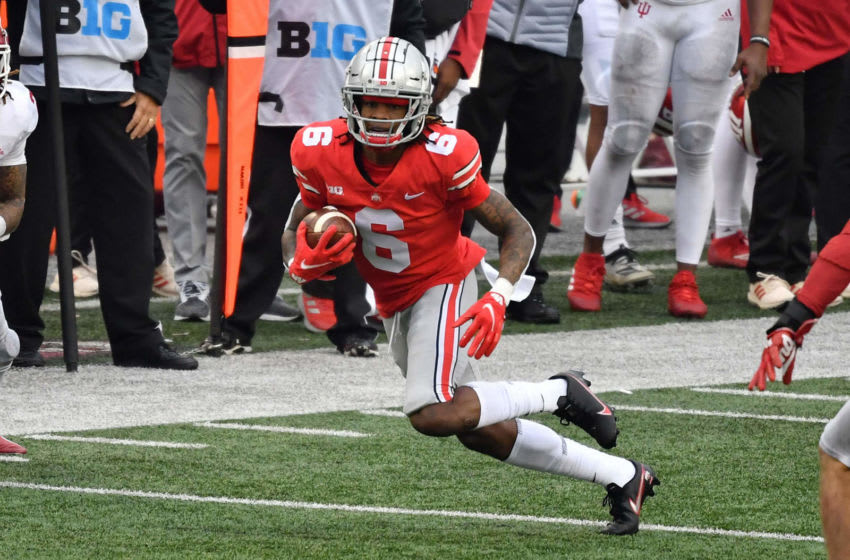 COLUMBUS, OH - NOVEMBER 21: Jameson Williams #6 of the Ohio State Buckeyes carries the ball against the Indiana Hoosiers at Ohio Stadium on November 21, 2020 in Columbus, Ohio. (Photo by Jamie Sabau/Getty Images)