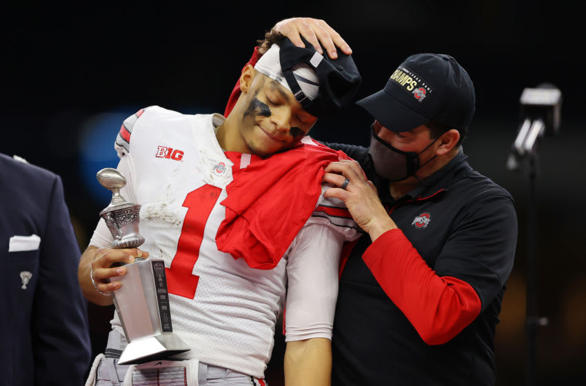 NEW ORLEANS, LOUISIANA - JANUARY 01: Justin Fields #1 and head coach Ryan Day of the Ohio State Buckeyes react after defeating the Clemson Tigers 49-28 during the College Football Playoff semifinal game at the Allstate Sugar Bowl at Mercedes-Benz Superdome on January 01, 2021 in New Orleans, Louisiana. (Photo by Kevin C. Cox/Getty Images)