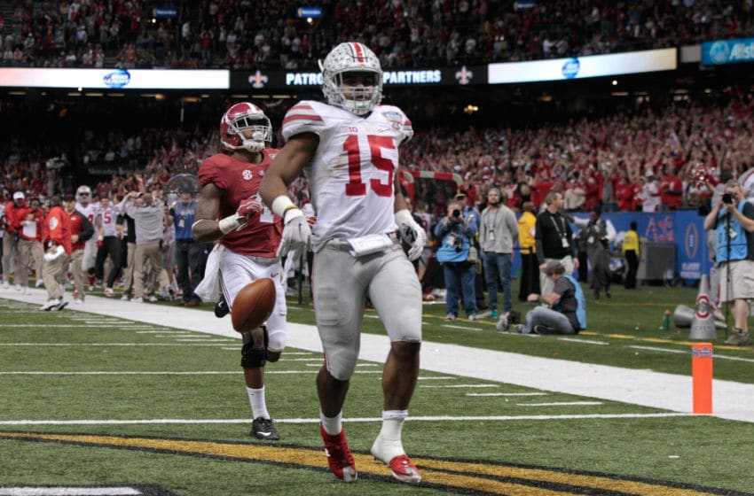 NEW ORLEANS, LA - JANUARY 01: Ezekiel Elliott #15 of the Ohio State Buckeyes celebrates after scoring a touchdown in the fourth quarter against the Alabama Crimson Tide during the All State Sugar Bowl at the Mercedes-Benz Superdome on January 1, 2015 in New Orleans, Louisiana. (Photo by Sean Gardner/Getty Images)