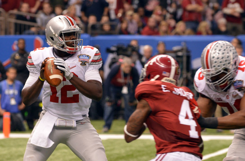 NEW ORLEANS, LA - JANUARY 01: Cardale Jones #12 of the Ohio State Buckeyes drops back to pass against the Alabama Crimson Tide during the Allstate Sugar Bowl at the Mercedes-Benz Superdome on January 1, 2015 in New Orleans, Louisiana. Ohio State defeated Alabama 42-35. (Photo by Lance King/Getty Images)