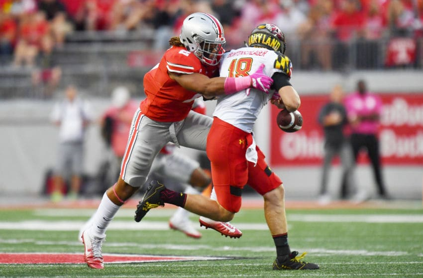 COLUMBUS, OH - OCTOBER 7: Chase Young #2 of the Ohio State Buckeyes hits quarterback Max Bortenschlager #18 of the Maryland Terrapins in the backfield causing a fumble in the third quarter at Ohio Stadium on October 7, 2017 in Columbus, Ohio. Ohio State defeated Maryland 62.14. (Photo by Jamie Sabau/Getty Images)