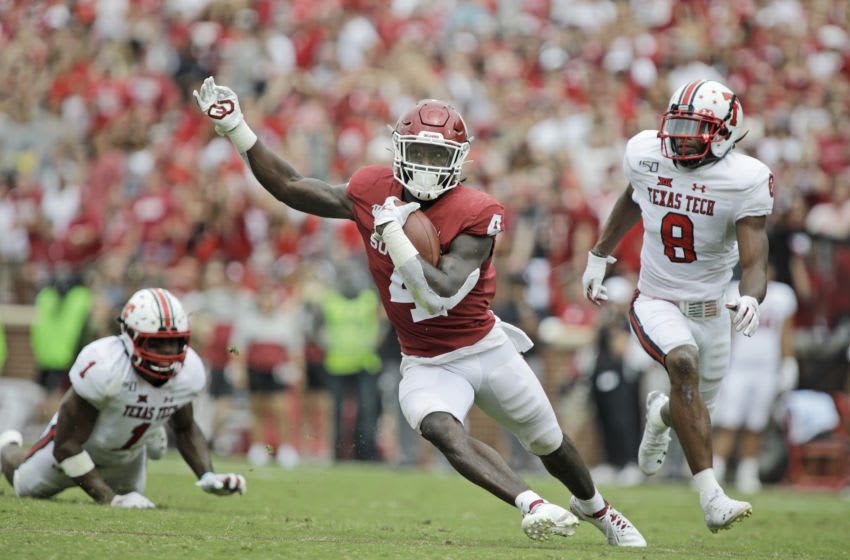 NORMAN, OK - SEPTEMBER 28: Running back Trey Sermon #4 of the Oklahoma Sooners scrambles against the defense of the Texas Tech Red Raiders at Gaylord Family Oklahoma Memorial Stadium on September 28, 2019 in Norman, Oklahoma. The Sooners defeated the Red Raiders 55-16. (Photo by Brett Deering/Getty Images)