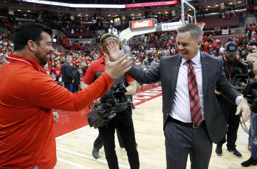 Mar 1, 2020; Columbus, Ohio, USA; Ohio State Buckeyes head coach Chris Holtmann (right) is congratulated by head football coach Ryan Day (left) following the second half against the Michigan Wolverines at Value City Arena. Mandatory Credit: Joseph Maiorana-USA TODAY Sports