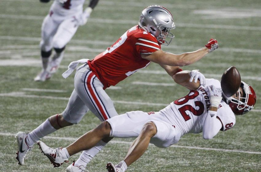 Ohio State Buckeyes safety Bryson Shaw (17) hits Rutgers Scarlet Knights wide receiver Christian Dremel (82) during the fourth quarter of a NCAA Division I football game between the Ohio State Buckeyes and the Rutgers Scarlet Knights on Saturday, Nov. 7, 2020 at Ohio Stadium in Columbus, Ohio. Cfb Rutgers Scarlet Knights At Ohio State Buckeyes