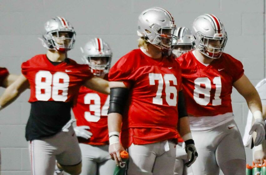 Harry Miller (76) arrived at Ohio State as a center before moving to guard to fill a vacancy this year Secondary art