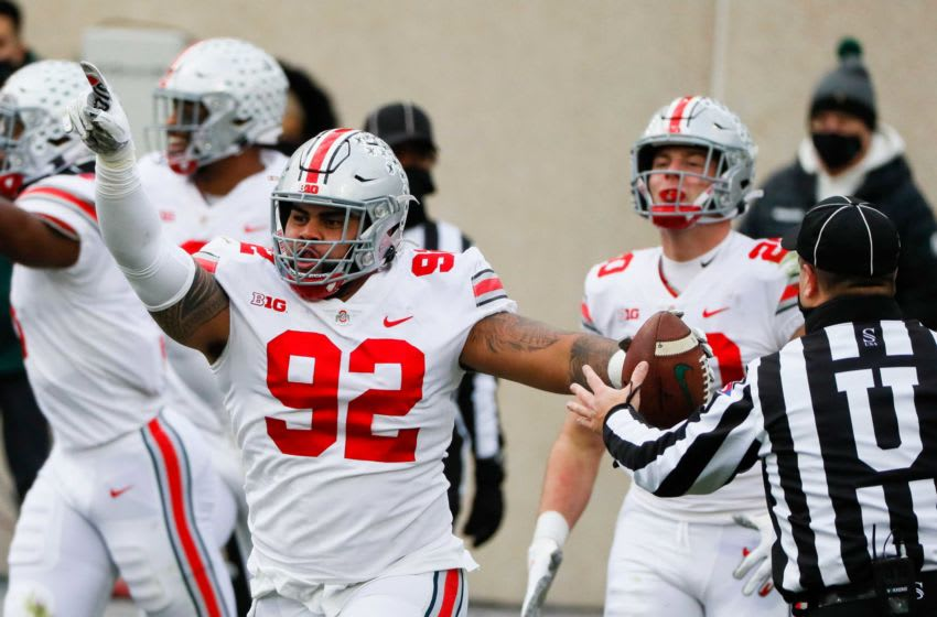Ohio State defensive tackle Haskell Garrett celebrates after batting a pass and catching it for a touchdown during the second quarter. Cfb Ohio State Buckeyes At Michigan State Spartans