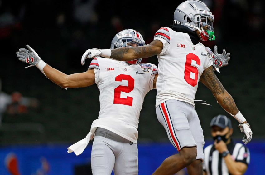 Ohio State Buckeyes wide receiver Jameson Williams (6) celebrates his touchdown with wide receiver Chris Olave (2) against Clemson Tigers in the fourth quarter during the College Football Playoff semifinal at the Allstate Sugar Bowl in the Mercedes-Benz Superdome in New Orleans on Friday, Jan. 1, 2021. College Football Playoff Ohio State Faces Clemson In Sugar Bowl