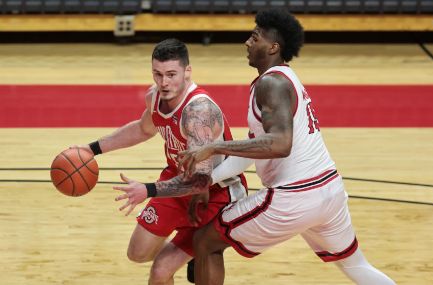 Jan 9, 2021; Piscataway, New Jersey, USA; Ohio State Buckeyes center Ibrahima Diallo (15) drives to the basket as Rutgers Scarlet Knights center Myles Johnson (15) defends during the second half at Rutgers Athletic Center (RAC). Mandatory Credit: Vincent Carchietta-USA TODAY Sports