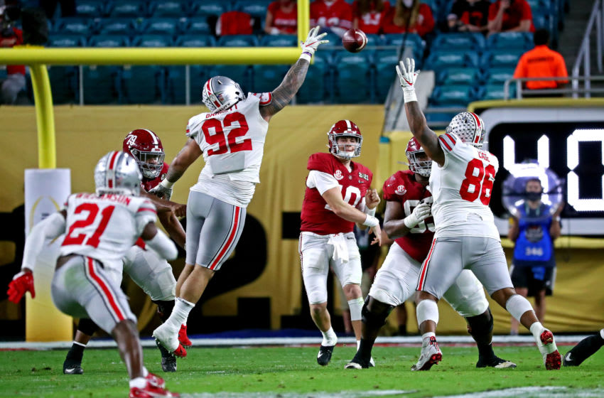 Jan 11, 2021; Miami Gardens, Florida, USA; Alabama Crimson Tide quarterback Mac Jones (10) throws a pass during the second quarter against the Ohio State Buckeyes in the 2021 College Football Playoff National Championship Game. Mandatory Credit: Kim Klement-USA TODAY Sports