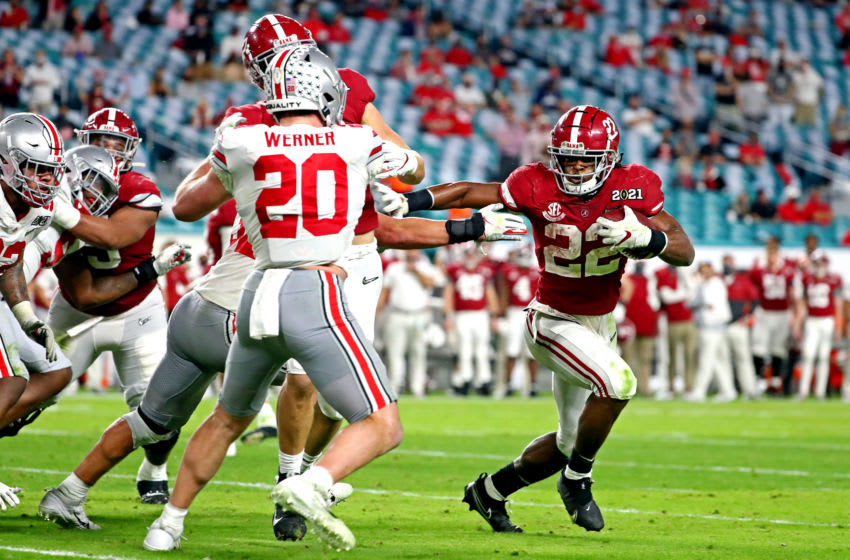 Jan 11, 2021; Miami Gardens, Florida, USA; Alabama Crimson Tide running back Najee Harris (22) runs the ball against Ohio State Buckeyes linebacker Pete Werner (20) during the third quarter in the 2021 College Football Playoff National Championship Game. Mandatory Credit: Kim Klement-USA TODAY Sports