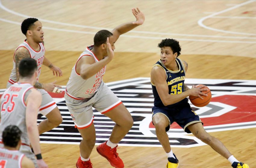Michigan Wolverines guard Eli Brooks (55) is guarded by Ohio State Buckeyes forward Zed Key (23) during Sunday's NCAA Division I Big Ten conference basketball game at Value City Arena in Columbus, Ohio, on February 21, 2021. Ceb Osu Mbk Mich Bjp 06