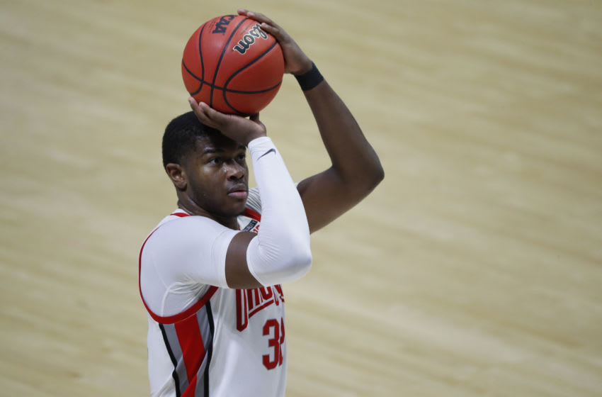 Mar 19, 2021; West Lafayette, Indiana, USA; Ohio State Buckeyes forward E.J. Liddell (32) shoots a free throw against the Oral Roberts Golden Eagles during the second half in the first round of the 2021 NCAA Tournament at Mackey Arena. Mandatory Credit: Joshua Bickel-USA TODAY Sports