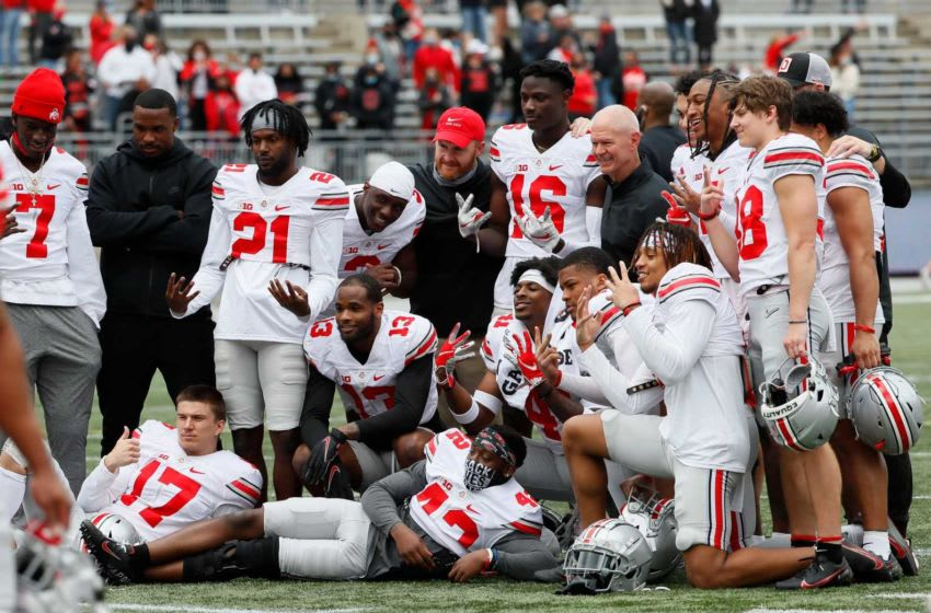 Kerry Coombs poses for a photo with the defensive backs following the Ohio State Buckeyes football spring game at Ohio Stadium in Columbus on Saturday, April 17, 2021. Ohio State Football Spring Game