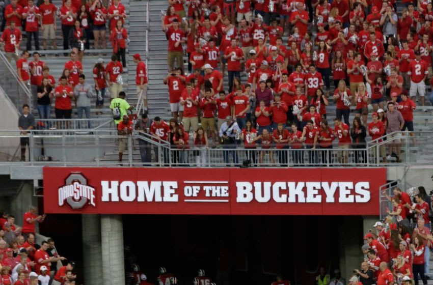 The Ohio State Buckeyes leave the field through a new tunnel in the south end of Ohio Stadium before Saturday's NCAA Division I football game between the Buckeyes and the Virginia Tech Hokies in Columbus on September 6, 2014. (Dispatch Photo by Barbara J. Perenic) Xtaosu14vt Bjp 04
