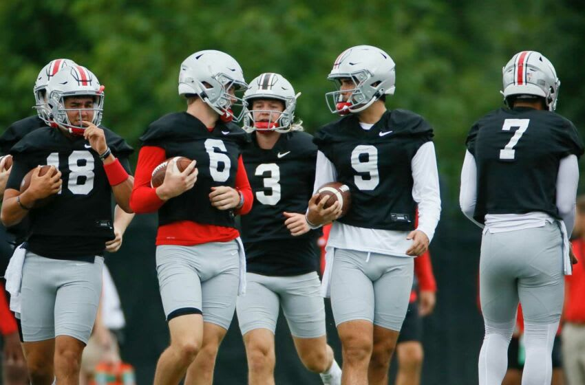 Ohio State Buckeyes quarterbacks Jagger LaRoe (19), J.P. Andrade (18), Kyle McCord (6), Quinn Ewers (3), Jack Miller III (9) and C.J. Stroud (7) warm up during football training camp at the Woody Hayes Athletic Center in Columbus on Wednesday, Aug. 18, 2021. Ohio State Football Training Camp