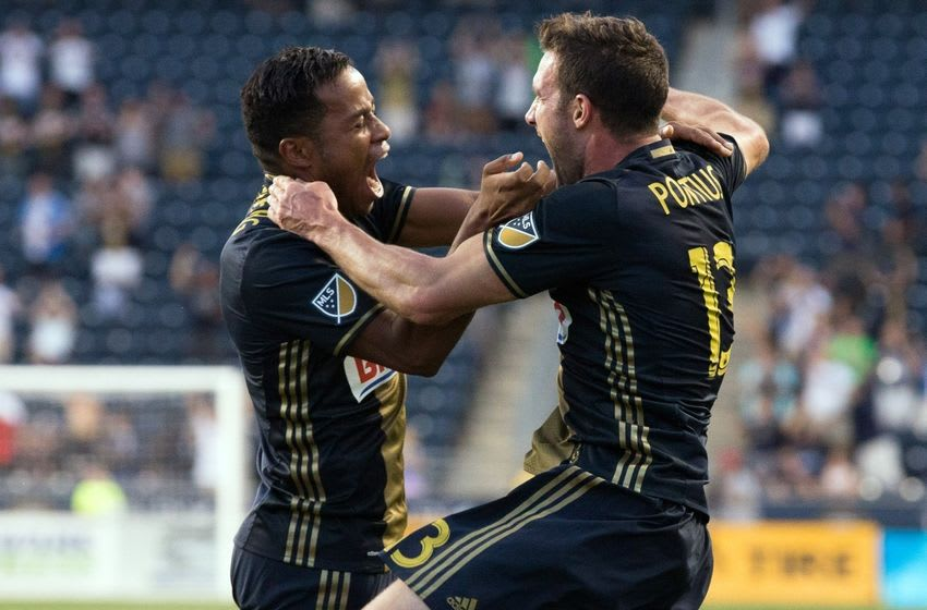 Jun 29, 2016; Philadelphia, PA, USA; Philadelphia Union forward Chris Pontius (13) celebrates with midfielder Roland Alberg (6) after scoring against the New York Red Bulls during the second half at Talen Energy Stadium. The Philadelphia Union won 2-1. Mandatory Credit: Bill Streicher-USA TODAY Sports