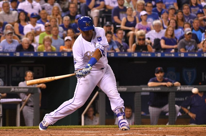 Jun 17, 2016; Kansas City, MO, USA; Kansas City Royals catcher Salvador Perez (13) hits a two run double in the seventh inning against the Detroit Tigers at Kauffman Stadium. The Royals won 10-3. Mandatory Credit: Denny Medley-USA TODAY Sports