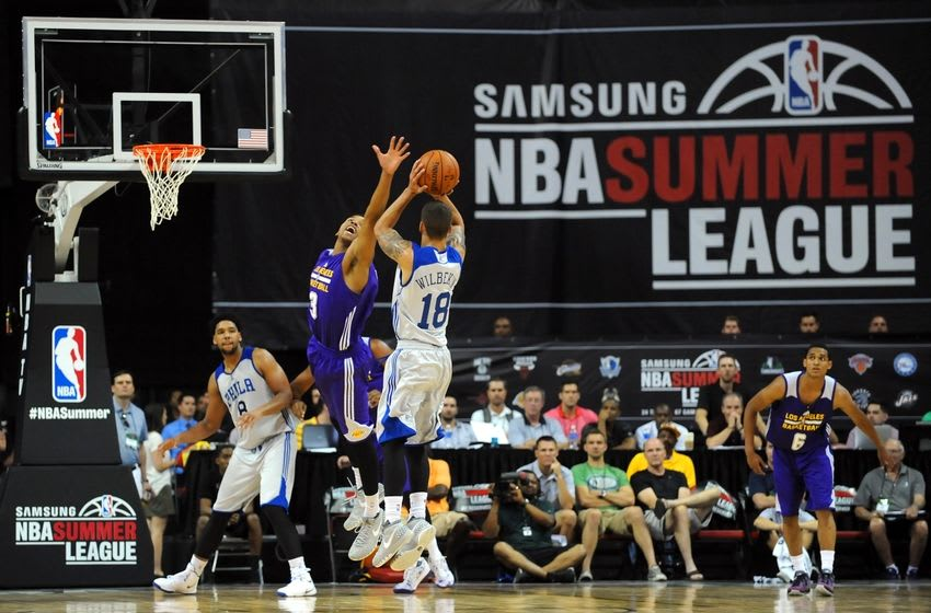Jul 11, 2015; Las Vegas, NV, USA; Philadelphia 76ers guard Scottie Wilbekin (18) attempts a 3-point shot over the defense of Los Angeles Lakers guard Anthony Brown (3) during an NBA Summer League game at Thomas & Mack Center. Mandatory Credit: Stephen R. Sylvanie-USA TODAY Sports