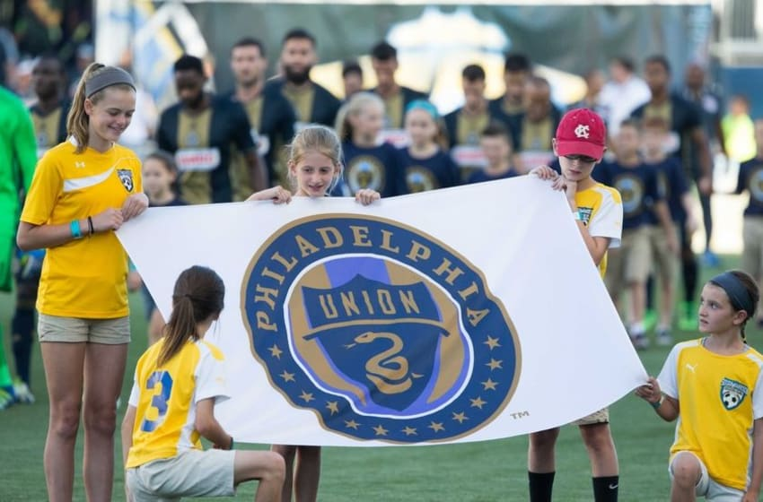 Jun 29, 2016; Philadelphia, PA, USA; Young fans hold a Philadelphia Union flag as players enter the field behind them before action against the New York Red Bulls at Talen Energy Stadium. Mandatory Credit: Bill Streicher-USA TODAY Sports