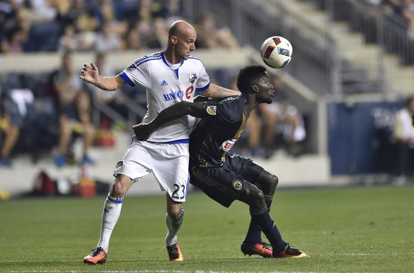 Sep 10, 2016; Philadelphia, PA, USA; Philadelphia Union forward C.J. Sapong (17) heads the ball against Montreal Impact defender Laurent Ciman (23) during the second half at Talen Energy Stadium. The game ended in a 1-1 draw. Mandatory Credit: Derik Hamilton-USA TODAY Sports