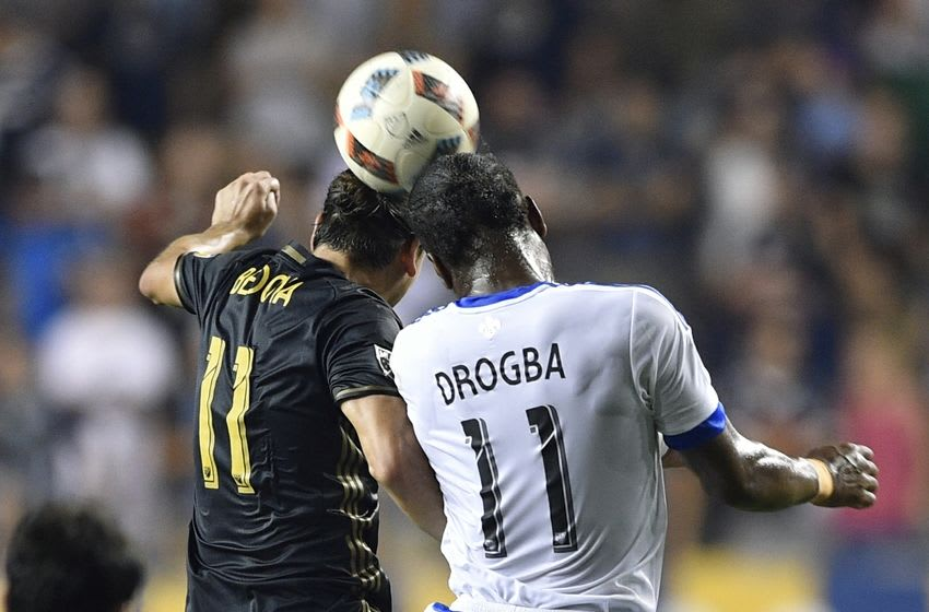 Sep 10, 2016; Philadelphia, PA, USA; Philadelphia Union midfielder Alejandro Bedoya (11) and Montreal Impact forward Didier Drogba (11) head the ball during the second half at Talen Energy Stadium. The game ended in a 1-1 draw. Mandatory Credit: Derik Hamilton-USA TODAY Sports