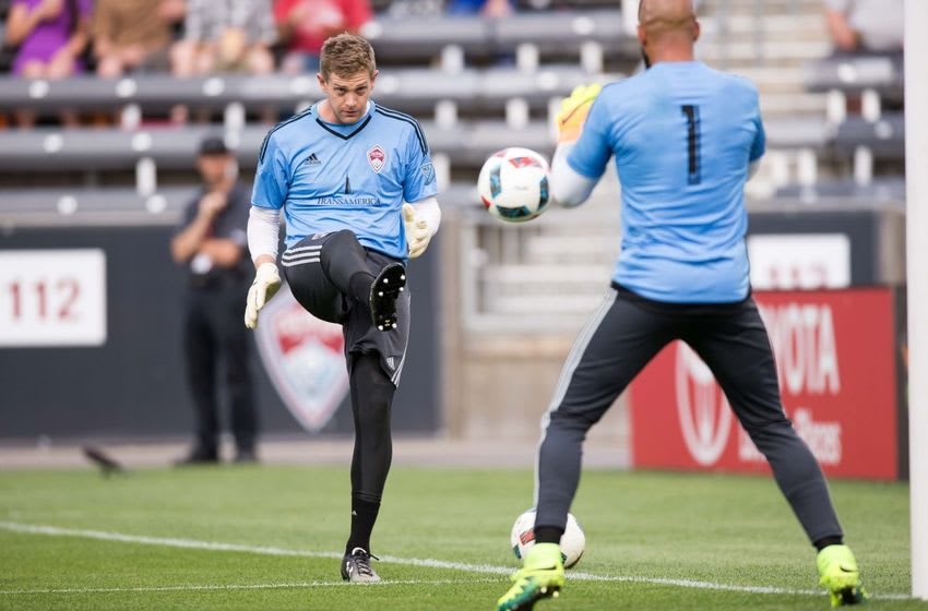 Jul 4, 2016; Commerce City, CO, USA; Colorado Rapids goalkeeper Zac MacMath (18) kicks the ball to goalkeeper Tim Howard (1) during warm ups before the match against the Portland Timbers at Dick