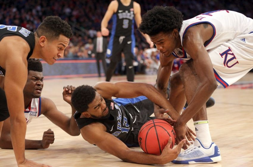Nov 15, 2016; New York, NY, USA; Duke Blue Devils guard Matt Jones (13) and Kansas Jayhawks guard Josh Jackson (11) fight for a loose ball during the first half at Madison Square Garden. Mandatory Credit: Brad Penner-USA TODAY Sports