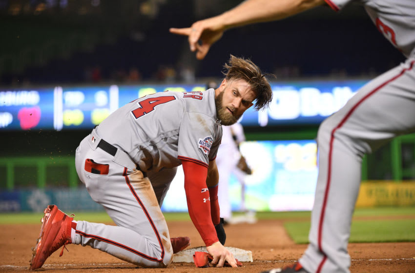 MIAMI, FL - SEPTEMBER 18: Bryce Harper #34 of the Washington Nationals at lands at third base in the sixth inning against the Miami Marlins at Marlins Park on September 18, 2018 in Miami, Florida. (Photo by Mark Brown/Getty Images)