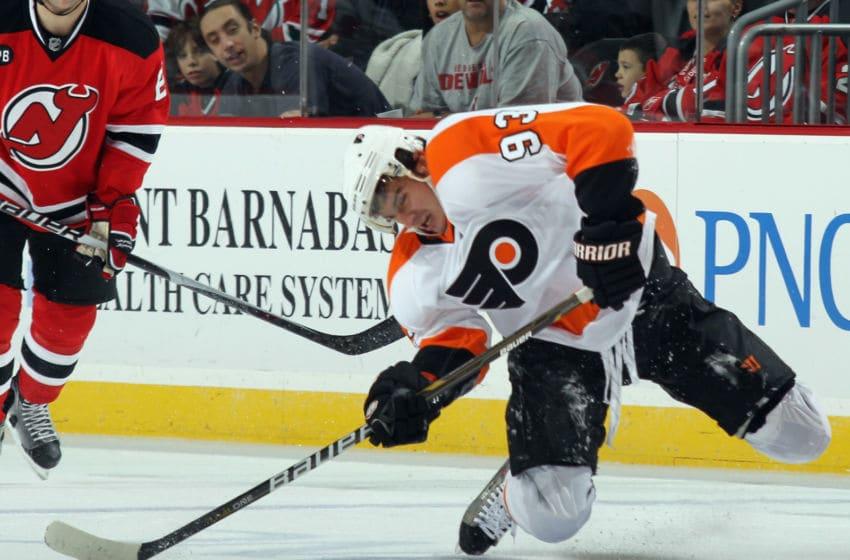 NEWARK, NJ - NOVEMBER 27: Nikolai Zherdev #93 of the Philadelphia Flyers struggles to play hockey. (Photo by Bruce Bennett/Getty Images)
