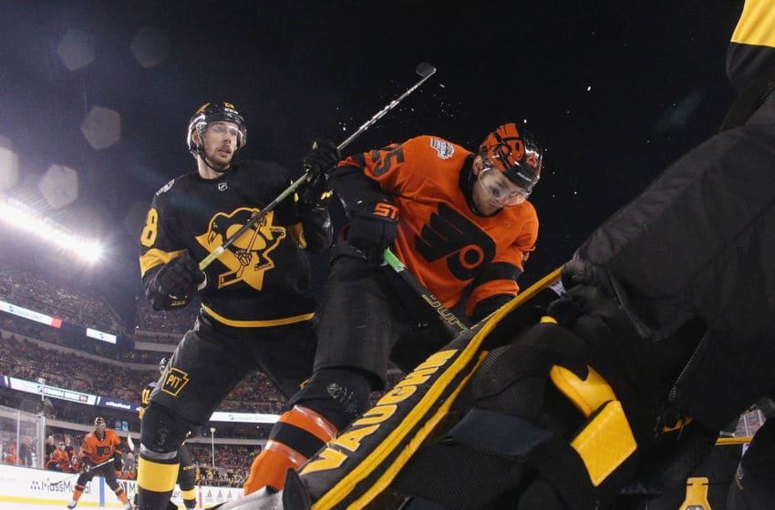 PHILADELPHIA, PENNSYLVANIA - FEBRUARY 23: Brian Dumoulin #8 of the Pittsburgh Penguins checks James van Riemsdyk #25 of the Philadelphia Flyers (Photo by Bruce Bennett/Getty Images)