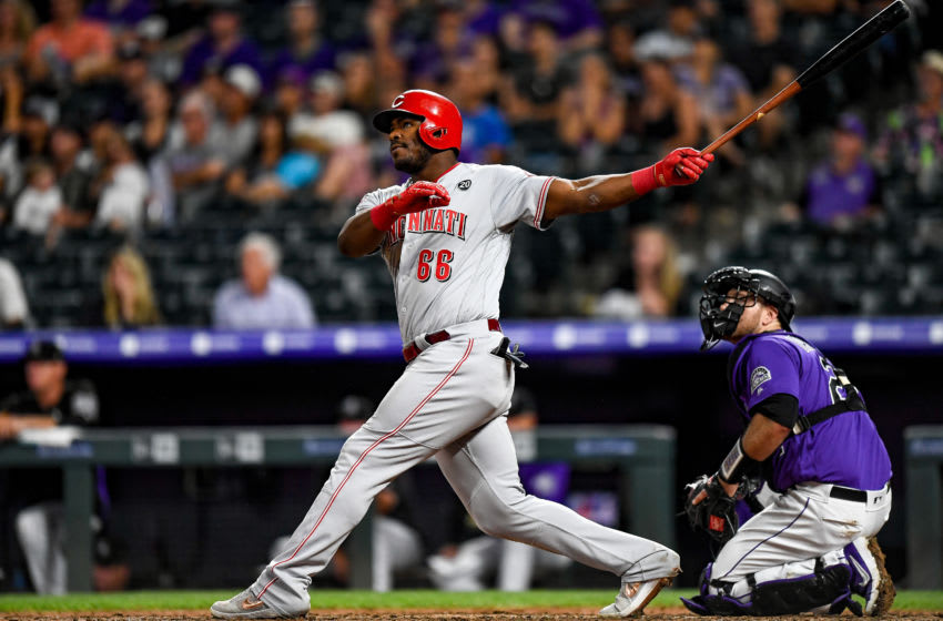 DENVER, CO - JULY 13: Yasiel Puig #66 of the Cincinnati Reds watches the flight of a sixth inning two-run homer against the Colorado Rockies at Coors Field on July 13, 2019 in Denver, Colorado. (Photo by Dustin Bradford/Getty Images)