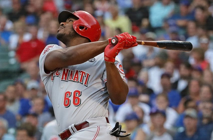CHICAGO, ILLINOIS - JULY 15: Yasiel Puig #66 of the Cincinnati Reds bats against the Chicago Cubs at Wrigley Field on July 15, 2019 in Chicago, Illinois. (Photo by Jonathan Daniel/Getty Images)