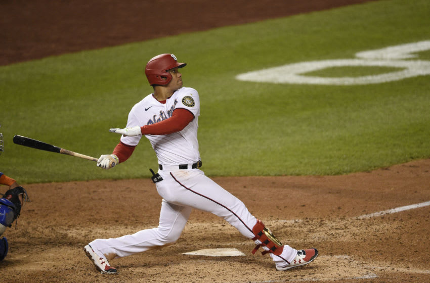 WASHINGTON, DC - SEPTEMBER 24: Juan Soto #22 of the Washington Nationals hits a double in the sixth inning against the New York Mets at Nationals Park on September 24, 2020 in Washington, DC. (Photo by Patrick McDermott/Getty Images)