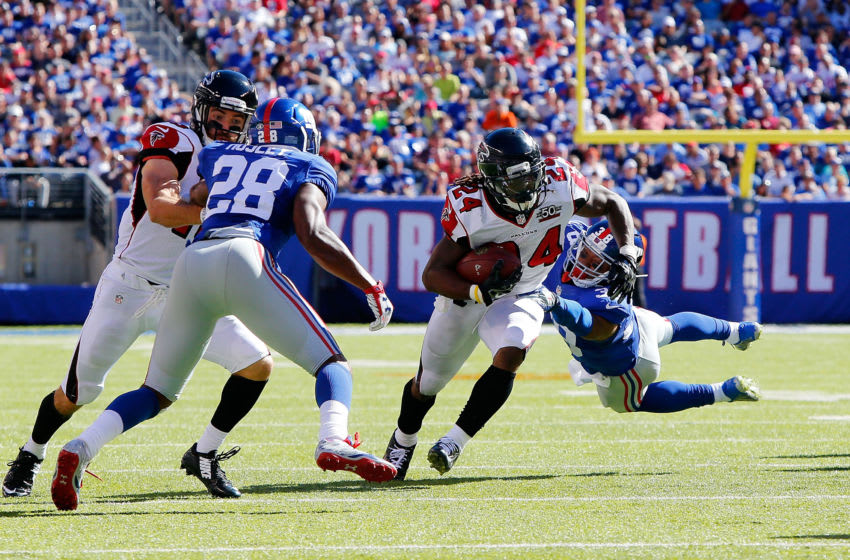 EAST RUTHERFORD, NJ - SEPTEMBER 20: (NEW YORK DAILIES OUT) Devonta Freeman #24 of the Atlanta Falcons in action against Trumaine McBride #38 of the New York Giants on September 20, 2015 at MetLife Stadium in East Rutherford, New Jersey. The Falcons defeated the Giants 24-20. (Photo by Jim McIsaac/Getty Images)